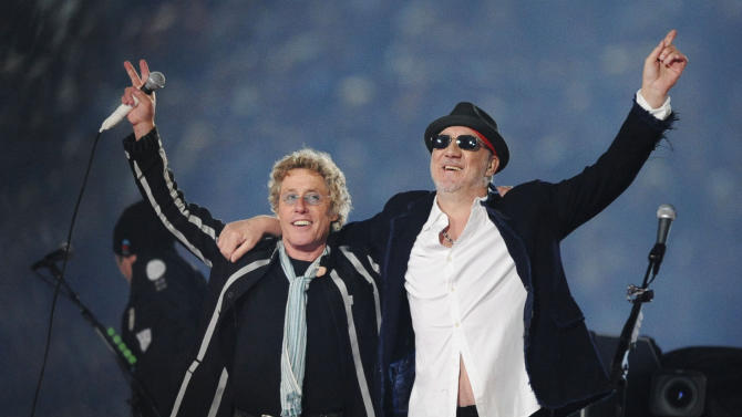 """FILE - In this Feb. 7, 2010 file photo, Roger Daltrey, left, and Pete Townshend acknowledge the crowd after performing during the second half of the NFL Super Bowl XLIV football game in Miami. Daltrey and Townshend are taking """"Quadrophenia"""" and other Who classics on the road for a U.S. tour in fall 2012, but first plan what Daltrey calls a great finale for the Olympic Games in London. The Who tour kicks off in Sunrise, Fla., on November 1. (AP Photo/Mark J. Terrill, File)"""