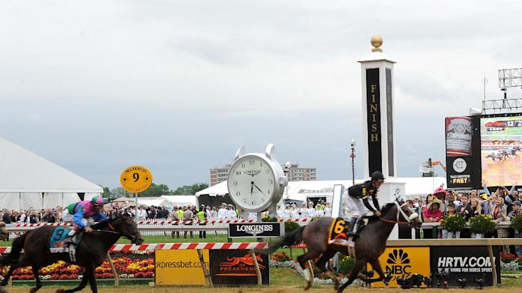 IMAGE DISTRIBUTED FOR LONGINES - Oxbow races by the Longines clock at the finish line as he wins the 138th running of the Preakness Stakes, Saturday, May 18, 2013, in Baltimore, MD. Longines, the Swiss watchmaker known for its famous timepieces, is the Official Watch and Timekeeper of the 138th annual Preakness Stakes. (Diane Bondareff/Invision for Longines/AP Images)