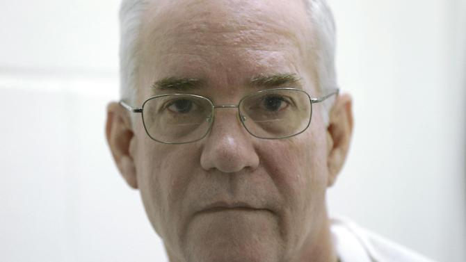 In this March 11, 2013 photo, inmate Ed Graf looks into a camera during an interview at the Alfred Hughes State Prison in Gatesville, Texas.  Graf, convicted of setting a fire that killed his two stepsons a quarter-century ago has been granted a new trial.  The Texas Court of Criminal Appeals on Wednesday, March 27, 2013,  ordered Graf's 1988 murder conviction set aside, pending a new trial. Graf was convicted of locking his stepsons in a shed and setting it on fire in Hewitt, Texas, in 1986. Two fire investigators then said the fire was arson. Experts now say that investigation was flawed and the fire could have been accidental.  (AP Photo/LM Otero)