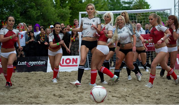 Porn Actresses With Body Paint Football Jerseys Take Part In A Fun Soccer Match Of Germany Vs Denmark On June 16, 2012 AFP/Getty Images
