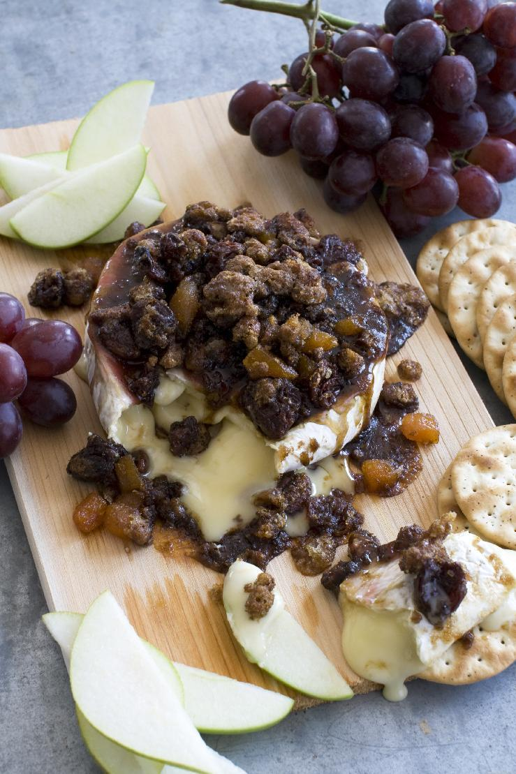 This April 1, 2013 photo taken in Concord, N.H. shows a recipe for cedar-planked pecan, bourbon and brown sugar glazed brie. (AP Photo/Matthew Mead)