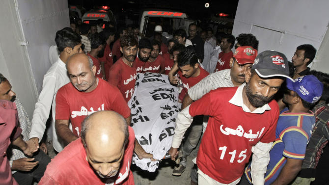 Pakistani volunteers carry the lifeless body of Zohra Shahid, a senior member of former Pakistani cricket star Imran Khan's Pakistan Tehreek-e-Insaf party in Sindh, to a hospital in Karachi, Pakistan, Sunday, May 19, 2013. Police said gunmen on a motorcycle shot and killed Shahid outside her home on Saturday, May 18, 2013, in the city of Karachi in southern Sindh province. (AP Photo/Fareed Khan)