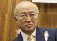 International Atomic Energy Agency (IAEA) chief Yukiya Amano arrives for a board of governors meeting in Vienna. Amano has urged Iran to sign a deal allowing greater clarity on its disputed nuclear drive and announced that new talks with Tehran would be held this week