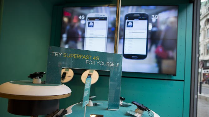 Mobile 4G devices are displayed in front of a bank of large screens in an Everything Everywhere (EE) store on Oxford Street in London, Wednesday, Feb. 20, 2013. Britain's communications regulator says five companies have won bids for the country's 4G spectrum - though the auction brought in 1 billion pounds less than Britain's Treasury expected. The regulator, Ofcom, says Everything Everywhere Ltd., Hutchison 3G, Telefonica, Niche Spectrum Ventures Ltd and Vodafone all won spectrum in the auction for the superfast airwaves. The auction brought in 2.3 billion pounds. (AP Photo/Matt Dunham)