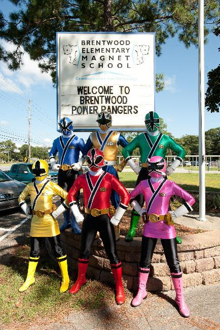 Power Rangers pose in front of the school before the emPOWER National Teacher Sweepstakes Winner presentation at Brentwood Elementary School on Friday Sept. 14, 2012, in Pensacola, Fla. (Photo by Michael Spooneybarger/Invision for Saban Brands /AP Images)
