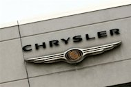 The Chrysler logo is seen on the outside of a dealership in Manhattan in 2009. Chrysler said Tuesday its US sales of cars and trucks rose 14 percent last month, the biggest annual gain in five years for August
