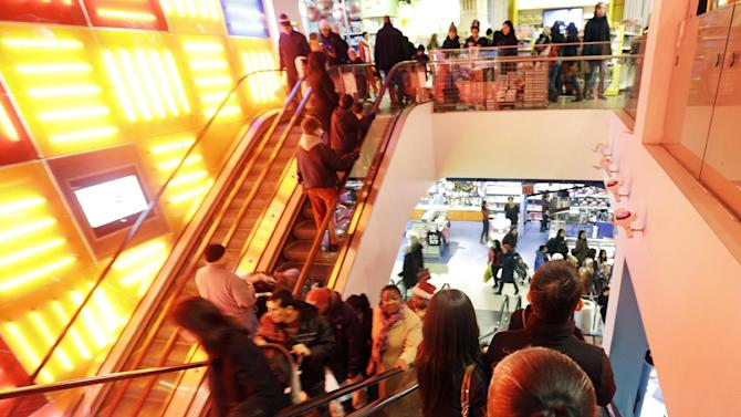 Shoppers navigate their way around Toys R Us in Times Square Wednesday, Dec. 26, 2012, in New York. This holiday season is shaping up to be the weakest since the country was in the middle of a deep recession in 2008. That not only shows that stores misread Americans' willingness to spend during this period of economic uncertainty. It also could indicate that the days of throngs of shoppers spending thousands of dollars willy nilly on holiday gifts may be long gone. (AP Photo/Frank Franklin II)