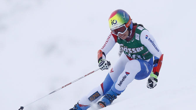 Gisin from Switzerland clears a gate during the first run of the World Cup Women's Giant Slalom race in Kuehtai ski resort