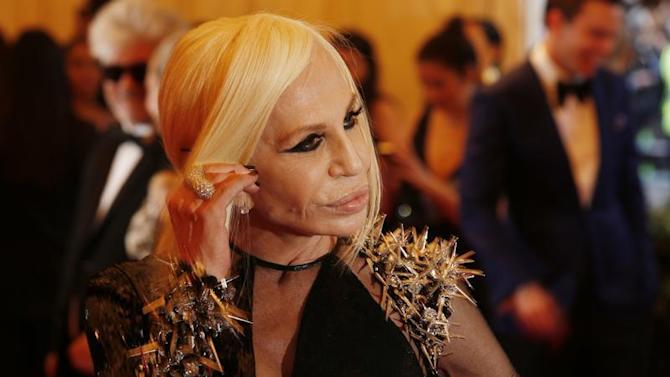 "Fashion designer Donatella Versace arrives at the Metropolitan Museum of Art Costume Institute Benefit celebrating the opening of ""PUNK: Chaos to Couture"" in New York"