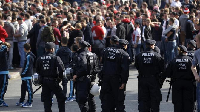 Police officers stand in front of 1.FC Cologne's supporters before their Bundesliga first division soccer match against Schalke 04 in Gelsenkirchen