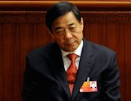 Chongqing Party Secretary Bo Xilai during the closing ceremony of the National People's Congress at the Great Hall of the People in Beijing, March 2012. The Chinese police chief at the centre of the biggest political scandal to engulf the communist party in decades has been charged with defection, power abuse and taking bribes