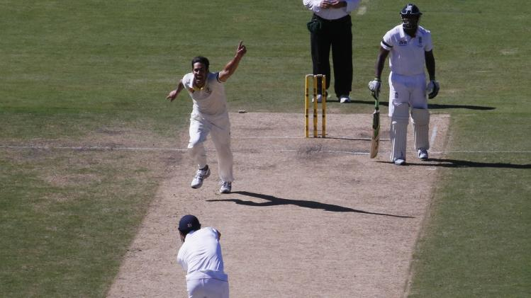 England's Cook is bowled out by Australia's Johnson as Johnson celebrates taking his wicket during second day's play in second Ashes cricket test at Adelaide Oval