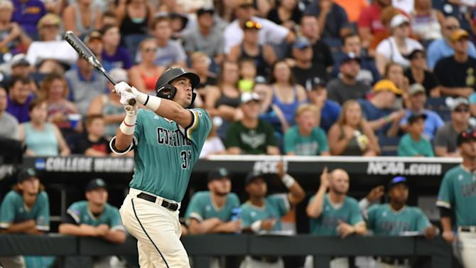 Coastal Carolina's G.K. Young follows the trajectory of his two-run triple during the third inning of an NCAA men's College World Series baseball game against TCU in Omaha, Neb., Saturday, June 25, 2016. (AP Photo/Ted Kirk)