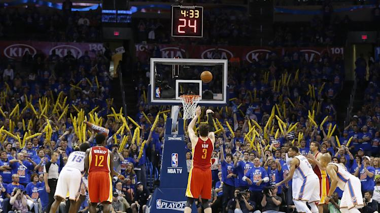 Houston Rockets center Omer Asik (3) shouts a foul shot in the fourth quarter of Game 5 of their first-round NBA basketball playoff series in Oklahoma City, Wednesday, May 1, 2013. Houston won 107-100. The Thunder, apparently doubting they could overcome an eight-point lead on their home court without Russell Westbrook, resorted to intentionally fouling Omer Asik — a 54 percent career foul shooter — with 5:33 to play. Asik went 8 for 12 from the line, extending Houston's lead to 101-92 with 3:53 remaining before Oklahoma City gave up the tactic. (AP Photo/Sue Ogrocki)