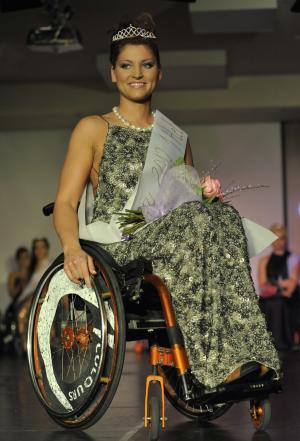 Katalin Eszter Varga, 26-year old perfume sales woman, smiles after winning the Miss Colour Hungary, the country's first beauty contest for wheelchair women in Budapest, Hungary, Saturday, Feb. 25, 2012. (AP Photo/Bela Szandelszky)