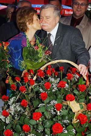 "FILE - In this  Sept. 30, 2003 file photo Lech Walesa, Poland's Solidarity leader and former president, gets a kiss from his wife Danuta, during a birthday party  in Gdansk, Poland. Walesa, the democracy icon and Nobel peace prize winner, has sparked controversy and outrage in Poland by saying in a TV interview Friday, March 1, 2013, homosexuals have no right to a prominent role in politics and that as a minority they need to ""adjust to smaller things"" in society. (AP Photo/Czarek Sokolowski, File)"