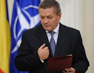Romanian Interior Minister Ioan Rus, seen here in May 2012, has resigned, citing &quot;unacceptable&quot; pressures amid controversy over his ministry&#39;s organisation of an impeachment referendum against president Traian Basescu