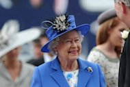 Britain&#39;s Queen Elizabeth II arrives on Derby Day, the second day of the Epsom Derby horse racing festival, in Surrey on June 2 -- the first official day of her Diamond Jubilee celebrations. She received a rapturous welcome from a flag-waving crowd of more than 100,000 at the racecourse Saturday as she kicked off four days of national celebrations