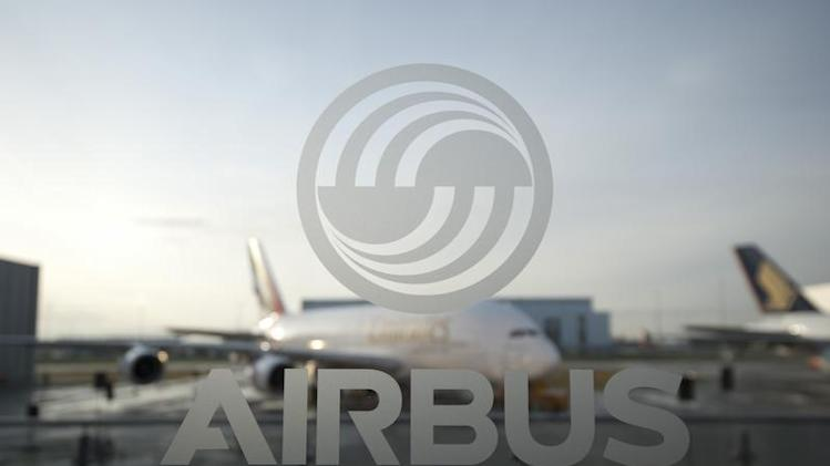 An A380 aircraft is seen through a window with an Airbus logo during the EADS / Airbus 'New Year Press Conference' in Hamburg
