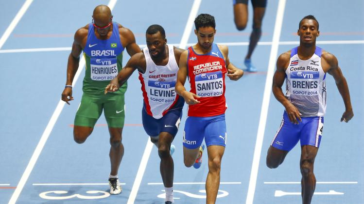 Henriques of Brazil, Levine of Britain, Santos of Dominican Republic and Brenes of Costa Rica finish in the men's 400 metres heats event at the world indoor athletics championships at the ERGO Arena in Sopot