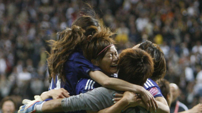 Japan players celebrate winning the final match between Japan and the United States at the Women's Soccer World Cup in Frankfurt, Germany, Sunday, July 17, 2011. The Japanese women's soccer team won their first World Cup Sunday after defeating USA in a penalty shoot-out.(AP Photo/Michael Probst)