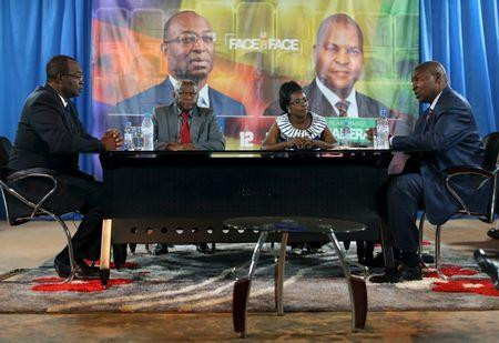 Touadera and Dologuele face each other during a live television debate ahead of Sunday's second round election, in Bangui