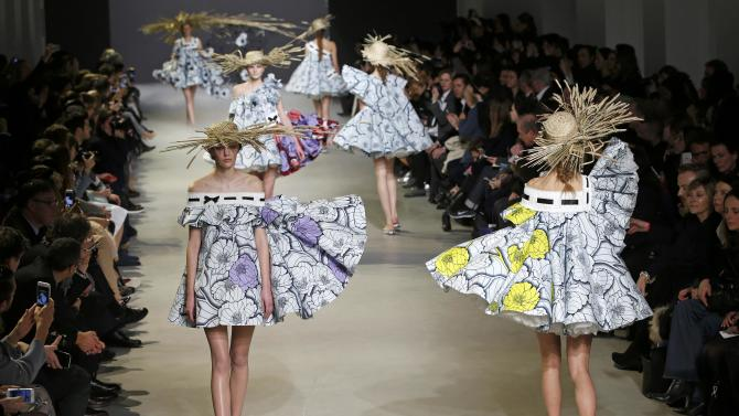 Models present a creation by Dutch designers Viktor Horsting and Rolf Snoeren as part of their Haute Couture Spring Summer 2015 fashion show in Paris