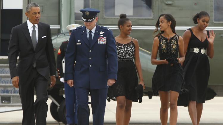 U.S. President Barack Obama and his family is escorted by U.S. Air Force Colonel John Millard at Joint Base Andrews, Maryland