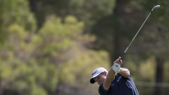 Nick Watney hits a shot of the ninth fairway during the Justin Timberlake Shriners Hospitals for Children Open golf tournament on Thursday, Oct. 4, 2012, in Las Vegas. (AP Photo/Julie Jacobson)