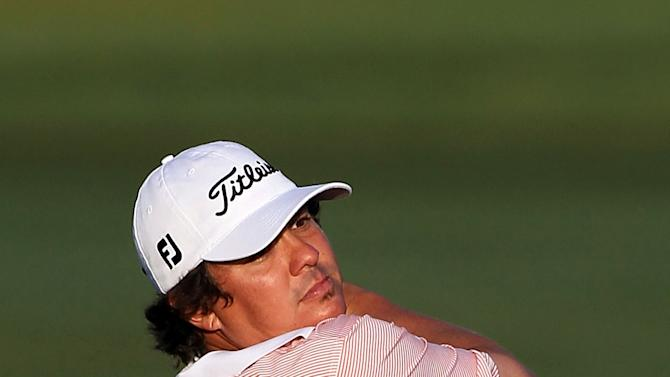 Jason Dufner hits a shot on the 11th hole
