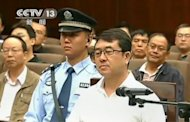 This frame grab, taken from Chinese television CCTV on September 18, shows former police chief Wang Lijun (C) facing the court during his trial in Chengdu, in southwest China's Sichuan province. Wang, who triggered a scandal that shocked the Communist Party, was sentenced to 15 years in prison on Monday for defection and other crimes, according to Xinhua