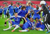Chelsea's players celebrate on the pitch with the trophy after Chelsea's 2-1 win in the FA Cup final match against Liverpool at Wembley Stadium in London, on May 5. Didier Drogba and John Terry made history as Chelsea withstood a late Liverpool onslaught to seal their fourth FA Cup final victory in six seasons with a 2-1 win