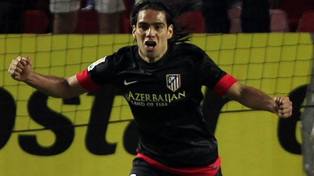 Atletico Madrid's Radamel Falcao celebrates after scoring against Sevilla during their Spanish First Division soccer match at Ramon Sanchez Pizjuan stadium in Seville April 21, 2013. REUTERS