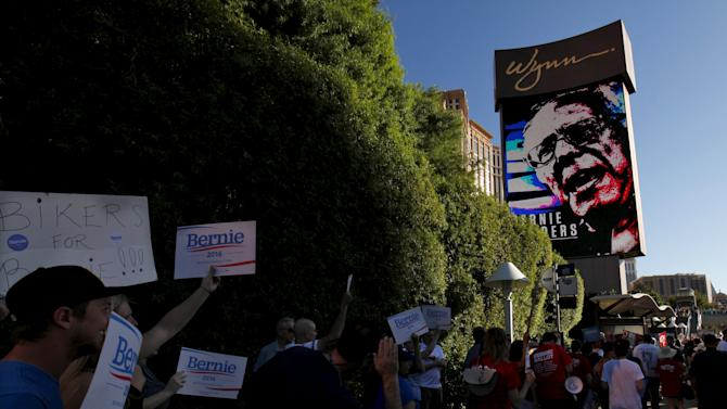 Supporters for democratic presidential candidate Bernie Sanders march outside  the Wynn Hotel in Las Vegas