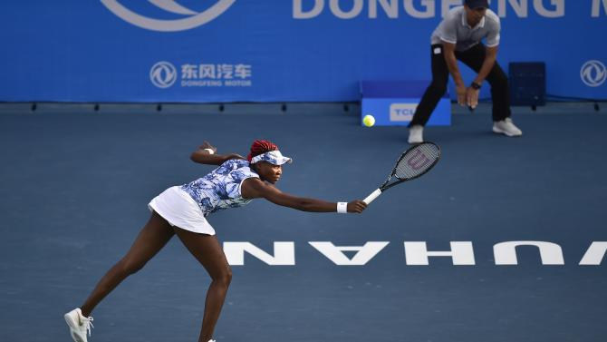 Williams hits a return against Garcia during their Wuhan Open women's singles first round match