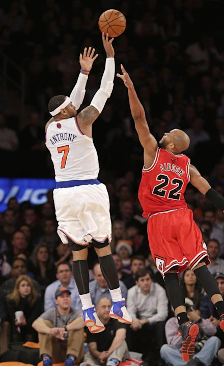 New York Knicks forward Carmelo Anthony (7) shoots over Chicago Bulls forward Taj Gibson (22) in the second half of their NBA basketball game at Madison Square Garden in New York, Wednesday, Dec. 11,