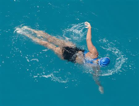 Diana Nyad, positioned about than two miles off Key West, Florida, swims towards the completion of her 111-mile trek from Cuba to the Florida Keys