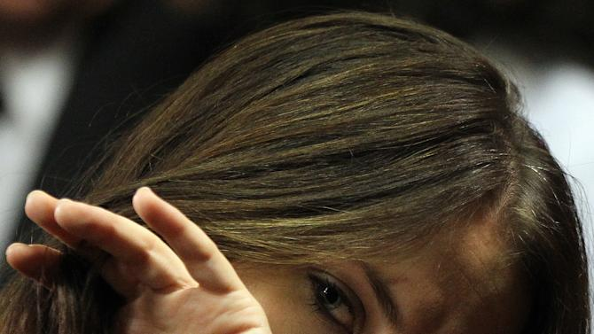 Olympic athlete Oscar Pistorius' sister Aimee Pistorius looks on during his bail hearing at the magistrate court in Pretoria, South Africa, Friday, Feb. 22, 2013. Pistorius was granted bail in the Pretoria Magistrate's Court on Friday. (AP Photo/Themba Hadebe)