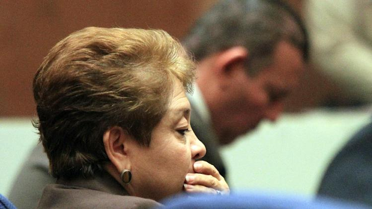 Teresa Jacobo, a former Bell City elected official listens to the judge as a guilty verdict is read in her trial on Wednesday, March 20, 2013, in Los Angeles.  Jacobo and four former elected officials were convicted of multiple counts of misappropriation of public funds, and a sixth defendant was cleared entirely. Former Mayor Oscar Hernandez and co-defendants Jacobo, George Mirabal, George Cole, and Victor Belo were all convicted of multiple counts and acquitted of others.  The charges against them involved paying themselves inflated salaries of up to $100,000 a year in the city of 36,000 people, where one in four residents live below the poverty line.   (AP Photo/Los Angeles Times, Irfan Khan, Pool)