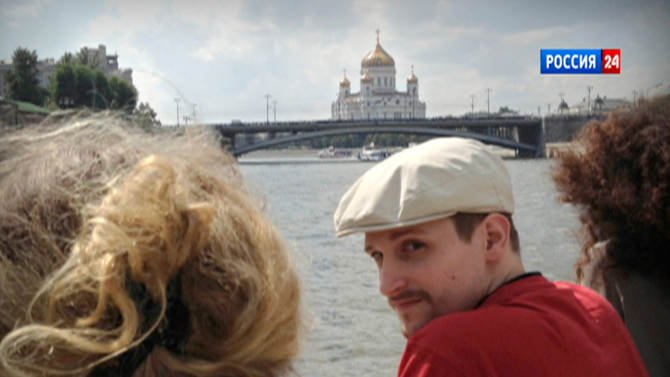 In this video frame grab provided by LifeNews via Rossia 24 TV channel, which has been authenticated based on its contents and other AP reporting, former National Security Agency systems analyst Edward Snowden looks over his shoulder during a boat trip on the Moscow River in Moscow, with the Christ the Savior Cathedral in the background. LifeNews said the video was shot in September 2013 and Snowden's lawyer, Anatoly Kucherena, confirmed the photo's authenticity. Snowden is calling for international help to persuade the U.S. to drop its espionage charges against him, according to a letter a German lawmaker released Friday after he met the American in Moscow. (AP Photo/LifeNews via Rossia 24 TV channel) TV OUT
