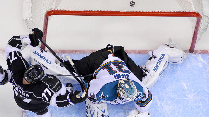 Los Angeles Kings center Jeff Carter, left, celebrates Dustin Brown goal past San Jose Sharks goalie Antti Niemi, of Finland, during the third period in Game 2 of their second-round NHL hockey Stanley Cup playoff series, Thursday, May 16, 2013, in Los Angeles.  (AP Photo/Mark J. Terrill)