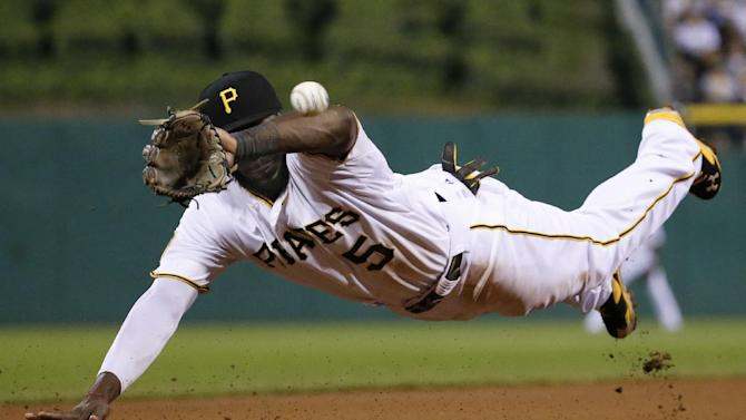Pittsburgh Pirates third baseman Josh Harrison dives but can't get his glove on a double hit down the third baseline by Boston Red Sox's Allen Craig during the eighth inning of a baseball game in Pittsburgh Tuesday, Sept. 16, 2014. (AP Photo/Gene J. Puskar)