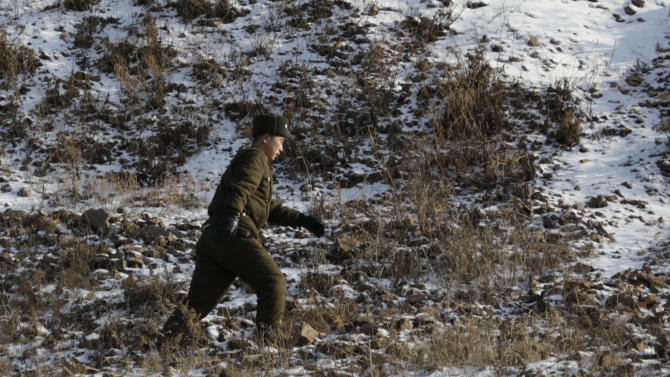 A North Korean soldier walks on the river bank of the North Korean town of Sinuiju, opposite side of Dandong, China on Wednesday, Feb. 6, 2013.  North Korea vowed last month to carry out its third nuclear test but has said nothing about timing. (AP Photo/Eugene Hoshiko)