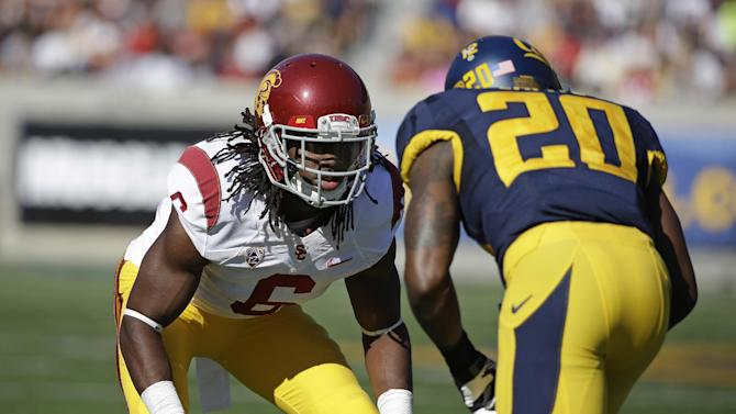 In this Nov. 9, 2013, file photo, Southern California cornerback Josh Shaw, left, lines up against California defensive back Isaac Lapite during the first quarter of an NCAA college football game in Berkeley, Calif. Shaw injured both ankles after leaping from a second-story balcony to save his 7-year-old nephew, Carter, from drowning in a pool. Shaw was named a team captain on Saturday, Aug. 23, 2014, and later that night was attending a family function at a cousin's apartment in his hometown of Palmdale when he saw his nephew, who can't swim, struggling in the pool