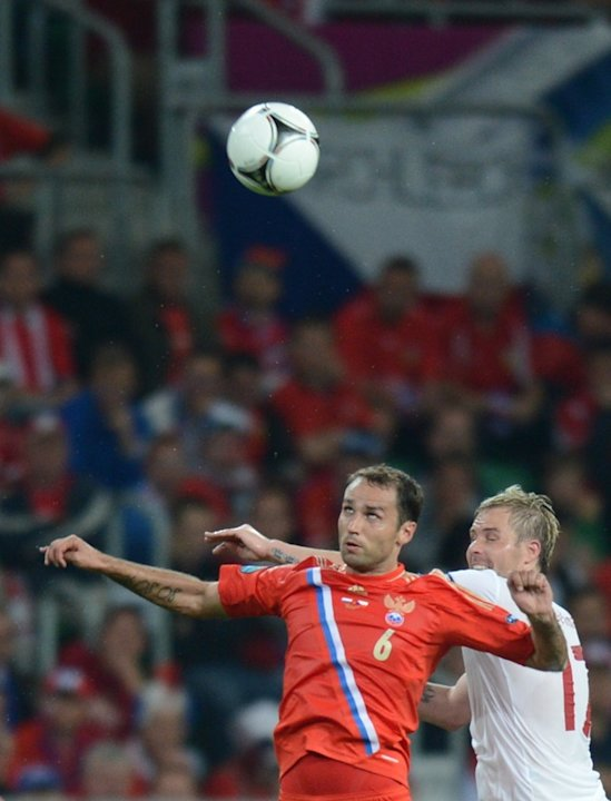 Russian Midfielder Roman Shirokov (L) Fights AFP/Getty Images