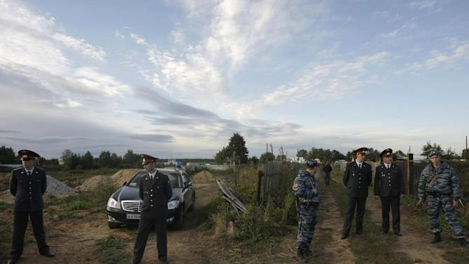 Police officers block the area of the crash site of the Russian Yak-42 jet near the city of Yaroslavl, on the Volga River about 150 miles (240 kilometers) northeast of Moscow,  Russia, Wednesday, Sept. 7, 2011.  The Yak-42 jet carrying the Lokomotiv ice hockey team crashed while taking off Wednesday near Yaroslavl. (AP Photo/Misha Japaridze)