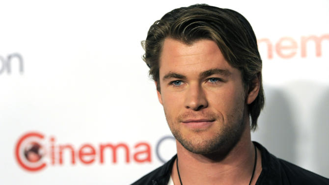 """Chris Hemsworth, star of the upcoming film """"Thor,"""" poses during the opening night of CinemaCon 2011, the official convention of the National Association of Theater Owners,  Monday, March 28, 2011, in Las Vegas. (AP Photo/Chris Pizzello)"""