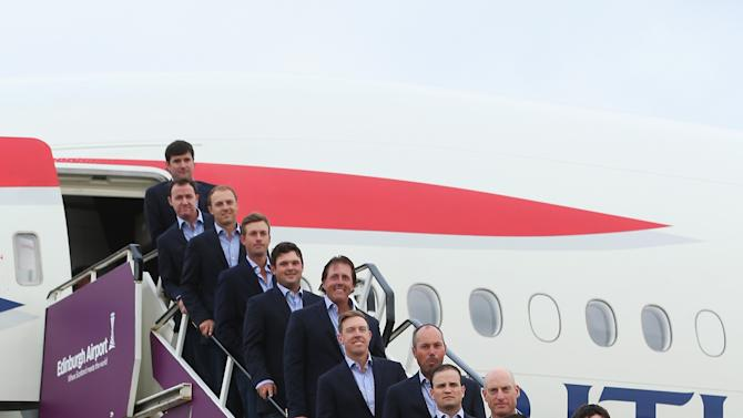 In this handout photo provided by Ryder Cup Europe, from left the U.S team Bubba Watson, Jimmy Walker, Jordan Spieth, Webb Simpson, Patrick Reed, Phil Mickelson, Hunter Mahan, Matt Kuchar, Zach Johnson, Jim Furyk, Rickie Fowler, Keegan Bradley and captain Tom Watson pose for media ahead of the 2014 Ryder Cup at Gleneagles, at Edinburgh Airport, Scotland, Monday, Sept. 22, 2014. (Photo by Andrew Redington/Ryder Cup Europe)