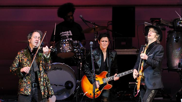 "Musicians Steve Wickham, left, and Mike Scott from The Waterboys perform with guitarist Wendy Melvoin, center, at ""The Music of Prince"" tribute concert at Carnegie Hall on Thursday March 7, 2013 in New York. (Photo by Evan Agostini/Invision/AP)"