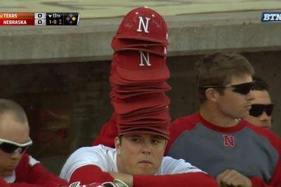Nebraska baseball player wears a leaning tower of rally caps